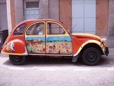 Car Art    A creative way to display artwork appears on this vintage Citroen 2CV in Carcasonne, France.