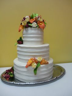 Artisan Bake Shop: Wedding Cake: Ruched Pleats of Fondant with Victorian Lavender Tulips and Pink Roses
