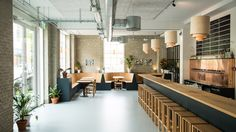 A disused iron factory in Copenhagen's Nørrebro neighbourhood provides the new home for the Brus Brewery, which features a bar, shop and restaurant
