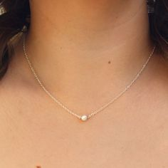 This delicate necklace is an amazing minimal accessory that adds the natural beauty of genuine pearl to any look. Great to wear for layering or as a simplistic bit of sheen! These pieces are handmade.