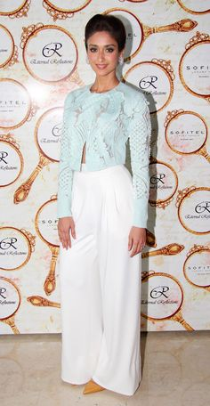 Ileana D'Cruz at a store launch wearing a beautiful Pankaj and Nidhi applique jacket with white pants.