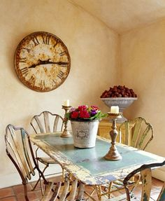 chippy table+rusty clock+patina walls+interesting chairs=great space!
