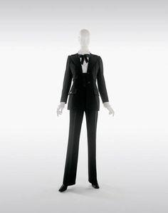 Yves Saint Laurent, Tuxedo with pants, haute couture collection, Fall-Winter 1966. Black barathea and satin silk, white organdy blouse. © Foundation Pierre Bergé-Yves Saint Laurent, Paris / Photo A. Guirkinger