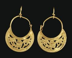 A PAIR OF BYZANTINE GOLD EARRINGS   CIRCA 6TH-7TH CENTURY A.D.   Crescentic in form, with an openwork design composed of an eagle with splayed wings, the body facing to the right, the head turned back, the beak open, bordered below by a beaded wire, the wire hoop along the concave edge, tapering at one end to a hook-and-loop closure; joined to modern earwires