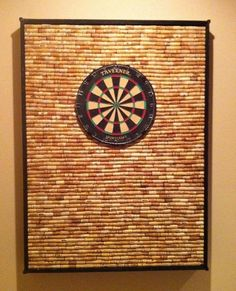 protect-your-wall-from-stray-darts-with-diy-dartboard-cabinet-made-wine-corks.w654.jpg 654×807 pixels