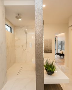 Walk behind your vanity to your walk-through shower! No glass needed. Concealed in floor drain, oversized cream tiles on walls and floor, waterfall shower fixture, backlit mirror, floating quartz countertop Window In Shower, Glass Shower, Shower Doors, White Master Bathroom, Master Shower, Small Bathroom, Walk Through Shower, Hidden Shower, Ensuite Bathrooms