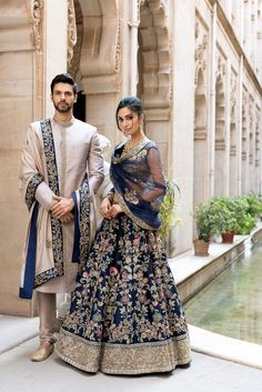 On him - A moon grey raw silk sherwani worn with a tassar silk shawl On her - Our mood blue resham &… Couple Wedding Dress, Wedding Dresses Men Indian, Wedding Outfits For Groom, Indian Bridal Outfits, Indian Bridal Fashion, Indian Bridal Lehenga, Indian Bridal Wear, Bridal Dresses, Indian Dresses