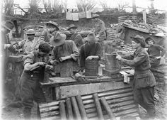 6th Field Company Engineers making small portable stoves at an outdoor workshop for use during the coming winter, 1 November. Creator:  Frank Hurley Australian First World War Official Exchange Collection (E (AUS) 1063)