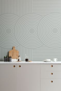 Starring a hypnotizing blend of concentric circles and straight stripes, our Satori wallpaper mural aims to relax you with subtle shades of Sage and satisfying shapes. This green geometric mural is a modern, abstract take on Japanese design, and is particularly inspired by zen gardens. A minimalist bedroom will benefit from the calming sense of motion that this mural invites in. The natural tones of Satori Sage will complement the peaceful color palette of a neutral living room. Japanese Geometric Wallpaper, Geometric Wallpaper Murals, Kitchen Wallpaper Murals, Inspirational Wallpapers, Japanese Design, Minimalist Bedroom, Zen Gardens, Relax, Calming