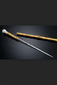 Dagger Cane Dated: century Measurements: overall length Blade length 13 There's a watch integrated into the handle of the cane, while a pull of the handle reveals a dagger nearly a foot in length. Walking Sticks And Canes, Wooden Walking Sticks, Walking Canes, Swords And Daggers, Knives And Swords, Cane Sword, Hidden Weapons, Cane Tips, Walking Staff