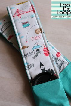 Also heart this one. DSLR Camera Strap Cover in Travel the World fabric w/ Lens Cap Pocket. $22.00, via Etsy.