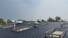 Industrial Metal Roof, report below explains the application scope of work for a liquid rubber roof coating to Metal Roof. Flat Roof Repair, Bragg Creek, Roof Coating, Industrial Metal, Metal Roof, Calgary, Sun Lounger, July 14, Patio