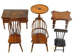 "Miniature doll furniture, six pieces: Georgian style mahogany library desk, five working drawers, inset leather top, some loss, six spade-footed legs, 4"" h.; burl walnut top table with bulbous ring and reel turned legs, 3 5/8"" h.; Windsor arm chair, side chair, and inlaid tilt top tea table, all marked ""F. & J.P."" underside; and black-painted farm side chair, gilt stenciling at crest, expected surface wear throughout. [From the Estate of Shepherd M. Holcombe, Sr. of West Hartford, CT]"