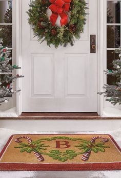 Give sweet salutations to your holiday guests with our Peppermint Stick Monogram Mat. Hand-stenciled, fade-resistant peppermint sticks support a wreath of holly, framing your initial.