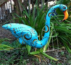 Each flamingo is hand painted and one-of-a-kind. Add something fun & frivolous to your lawn, or even as an accent to your home decor. Custom orders. You choose colors and design.  Each bird is spray coated with a protective clear coating. Place your order today and be the envy of the neighborhood.