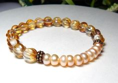 Love this Freshwater Pearl bracelet made with 10 beautiful Blush Freshwater Pearls surrounded by 8mm Champagne colored Czech glass. This is too pretty to capture on camera! Freshwater Pearl Properties