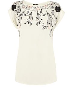 This short sleeved t-shirt has a delicate illustrative print by Rosie Lovelock around the neckline.