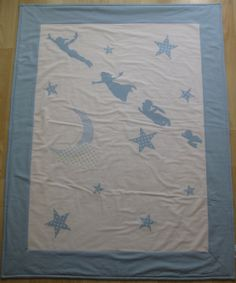 Blue and white cotton baby cot blanket/quilt with peter pan design. on Etsy, $67.51