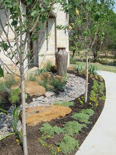"""""""Tx Xeriscape flowerbed design""""    Flat gardens are not good.  Do not have a garden that is flat with only grass.  The energy moves too fast over the flat field and is not harmonizing or meandering. Have raised planting beds, tall trees and shrubbery. If you can't then place a statue, a fountain, a large pot with flowers in it or create meandering paths in the flat garden."""