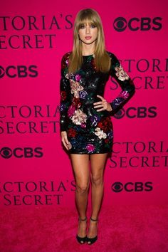 Taylor Swift did her red hot and sexy leg show on the pink carpet by wearing her black dress with flowers in it.
