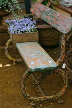 Nicely weathered bench displaying many paint layers.   Petersham Nurseries, Richmond Surrey UK