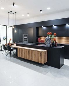 "Black adds a hit of posh style to any cooking Space . For a less Stark ,but equally chic option, consider""almost Black"" colors that are… Kitchen Room Design, Luxury Kitchen Design, Contemporary Kitchen Design, Kitchen Cabinet Design, Home Decor Kitchen, Interior Design Kitchen, Kitchen Cupboards, Küchen Design, House Design"