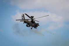 A US Army AH-64D Longbow Apache helicopter of the 4th Attack Reconnaissance Battalion, 2nd Combat Aviation Brigade fires rockets during a combined U.S. and Republic of Korea Army rotary wing aircraft demonstration at Biseung Range, South Korea, Oct. 6, 2014. U.S. Army photo by Sgt. 1st Class Vincent Abril