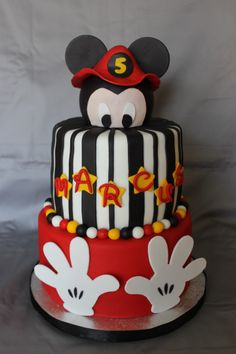 Fireman Mickey Mouse birthday cake - I used a styrofoam ball for the head and covered it in fondant. The fireman hat was made with gum paste, and so were the hands on the bottom tier.