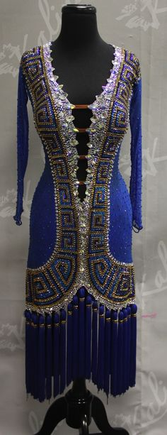 Blue. long-sleeved latin dress with an intricate stoning pattern and tassel fringe from Designs by Kalina. Visit http://ballroomguide.com/comp/attire/lady.html for more info about competition attire.
