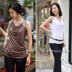 hermosa blusa drapeada con aplicaciones en los hombros ideal para esconder ese rollito de la cintura en algodón lycra tallas S-M-L