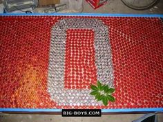 bottle cap table for the bar in the basement eventually Bottle Cap Table, Beer Bottle Caps, Beer Caps, Bottle Top, Bottle Cap Projects, Bottle Cap Crafts, Beer Cap Art, Ohio Buckeyes, Beer Pong Tables