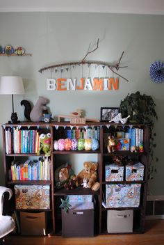 My babies nursery: Branch name sign, books, toys, and attractive storage solutions. DIY, wooden toys, green baby room, baby boy room, DIY stuffed animals, DIY mobile, DIY bunting, wall art, animals, whimsical woodland, nursery