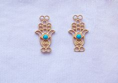 2pcs goldplated  hamsa by youyouspace on Etsy, $7.00