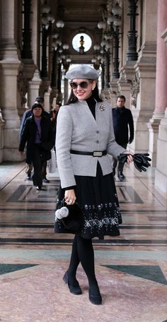 STYLING PROCESS: The Starting Point: Embelllished full wool skirt The Complementary Pieces: Black cashmere turtleneck; gray tweed wool jacket. The Finishing Touches: Gray wool beret; black shoes and belt; mink fur bag; sterling silver jewelry...Susana Fernandez | A Key to the Armoire
