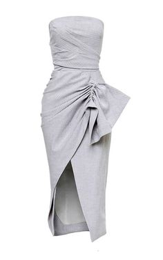 This strapless **Maticevski** dress features square neck with a fitted ruched bodice, a wraparound design at the front with a draped ruffle at the hip, and a knee length pencil skirt with a split at the front.