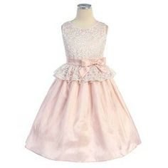 Exquisite special occasion pink dress by designer Sweet Kids is sure to delight your toddler little girl this season.  Simply perfect sleeve...