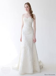 2015 spring wedding dresses | Lucia sleeveless gown with illusion neckline and beaded bodice.