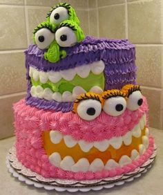 Monster Cake. I'm thinking this for the boys bday with camo cake and boy colored monsters