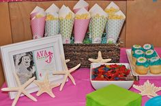 mermaid birthday party cones, maybe with popcorn Fishy crackers Or fish/star shaped candies