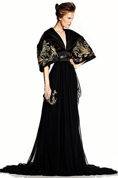 Why limit it to decor? McQueen effortlessly translates black lacquer and gold leaf into an elegant frock.