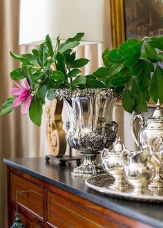 Silver Tea Service and a silver urn sit atop a dining room sideboard. - Photo: John Bessler / Design: Lisa Hilderbrand with Sarah Hamlin Hastings Southern Charm, Southern Style, Southern Living, Vintage Silver, Antique Silver, Argent Antique, Champagne Buckets, Tea Service, Home Living