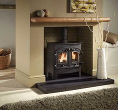 Wood burning fireplace design with a sophisticated European-style combines powerful catalytic heating - Hupehome New Homes, Fireplace Design, Stove, Home, Wood Burning Fireplace, Wood Burning Stove, Fireplace Bookshelves, Inglenook Fireplace, Wood Stove Surround