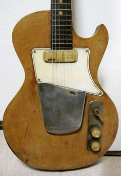 1950s Teisco or Guyatone. Made in Japan. Old vintage yellow electric guitar. Teisco was a Japanese manufacturer of affordable musical instruments from 1948 until 1969; brand is now owned by Kawai Musical Instruments. Guyatone is also a Japanese manufacturing company of guitars & pedals.