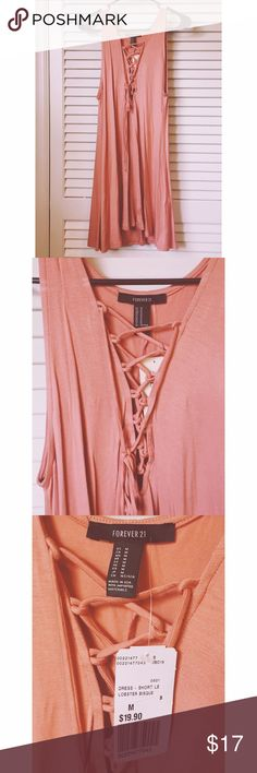 🌸 Forever21 Lace-Up Dress 🌸 NWT Beautiful peach/salmon colored Lace-up dress from forever21. New with tags!! Forever 21 Dresses Mini