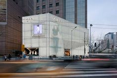 Ports 1961 glows at dusk. (Shengliang Su) From Functional to Fashionable: glass blocks used to create a glowing facade in Shanghai. Located in a high-end f Brick Building, Building Design, Shanghai, Facade Engineering, Atrium Design, Masonry Construction, Shop Facade, Glass Brick, Modern Buildings