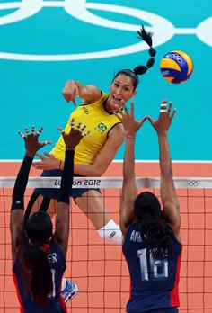 Jaqueline Carvalho #8 of Brazil spikes the ball against Foluke Akinradewo #16 and Destinee Hooker #19 of United States during the Women's Volleyball gold medal match on Day 15 of the London 2012 Olympic Games #Kinesiology #Tape #Taping