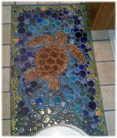 Ceramic and Glass Tile mosaic bar top!    I'm making something along these lines for the tiki bar. SO CUTE!