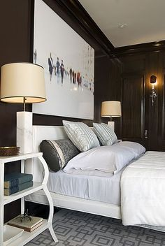 Dark bedroom walls and an incredible defocused, large-scale figurative photo- so chic.