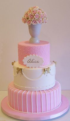 First birthday cake Would be cute in Purples and Aquamarines. Butterfly on the top and where the bows are.