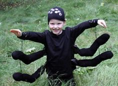 No Sew Spider Costume: 2 pairs of black socks stuffed with shopping bags. Black duct tape on black shirt.